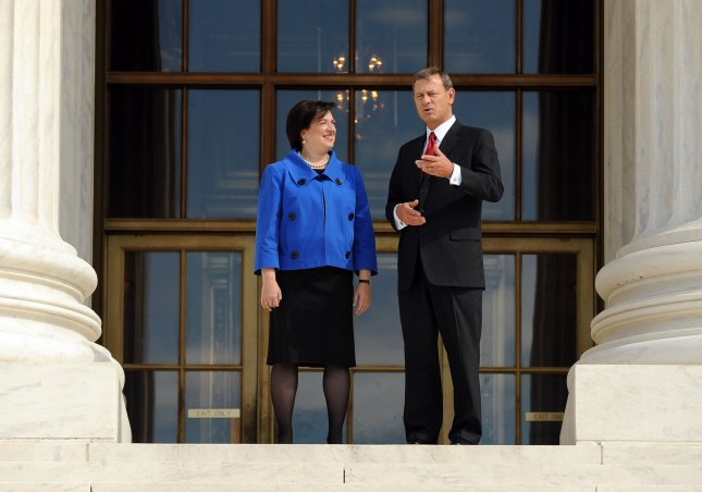 Supreme Court Justice Elena Kagan and Chief Justice John Roberts stand in front of the Supreme Court following her investiture ceremony in Washington on October 1, 2010. UPI/Roger L. Wollenberg
