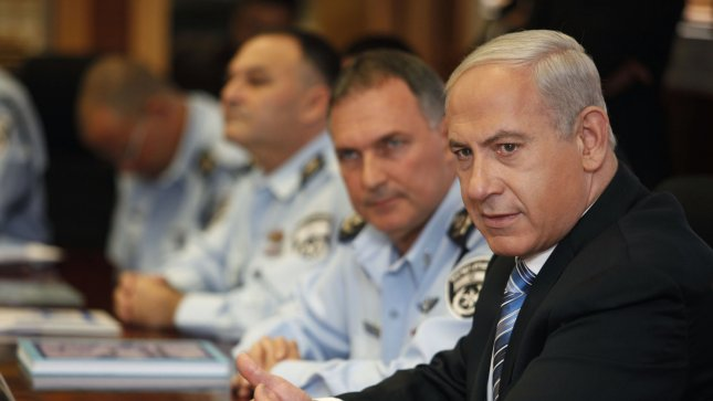 Israeli Prime Minister Benjamin Netanyahu attends a meeting during a visit to the national police headquarters in Jerusalem on November 22, 2012. UPI/Gali Tibbon/Pool