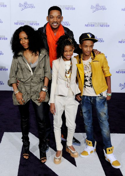 Will Smith, rear, and his wife Jada Pinkett Smith (L) pose with their daughter Willow (2nd-L) and son Jaden attend the premiere of the 3D motion picture documentary Justin Bieber: Never Say Never at Nokia Theatre in Los Angeles on February 8, 2011. UPI/Jim Ruymen