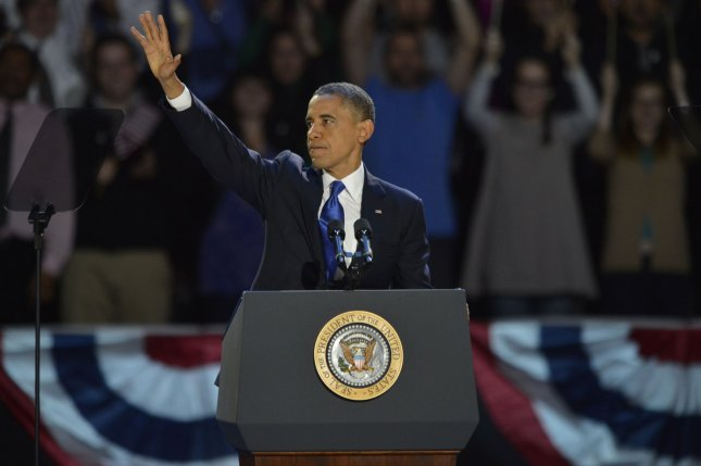 President Barack Obama waves as he celebrates his victory over Republican challenger Mitt Romney during their election night rally in Chicago on November 6, 2012. UPI/Kevin Dietsch