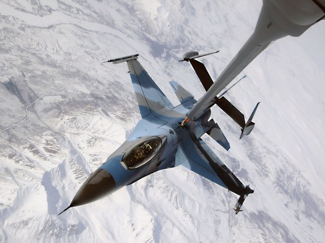 An F-16 Fighting Falcon disconnects from a KC-10 Extender after being refueled during a Red Flag-Alaska exercise on April 22, 2009. The F-16 is from the 18th Aggressor Squadron at Eielson Air Force Base, Alaska. (UPI Photo/Jonathan Snyder/US Air Force)