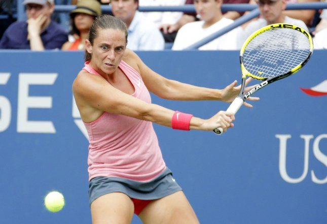 Roberta Vinci, shown at the 2013 U.S. Open, dropped a first-round match Tuesday at the ASB Classic in New Zealand. Vinci was the tournament's No. 1 seed but lost in three sets to wild-card entrant Ana Konjuh. UPI/John Angelillo