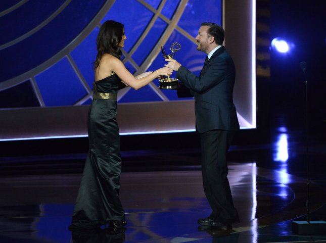 Ricky Gervais, right, presents Sarah Silverman of Sarah Silverman: We Are Miracles with the award for outstanding writing for a variety, music or comedy special during the Primetime Emmy Awards at the Nokia Theatre in Los Angeles on August 25, 2014. UPI/Pat Benic