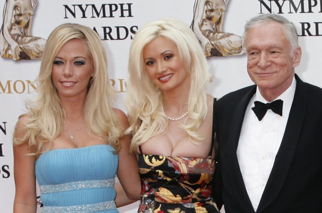 Kendra Wilkinson (L) with Holly Madison and Hugh Hefner (R) in June 2007. The reality star declared she never wants to be friends with Madison again Wednesday. File photo by David Silpa/UPI