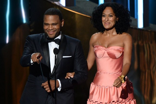Actor Anthony Anderson (L) and actress Tracee Ellis-Ross onstage during the 67th Primetime Emmy Awards in Los Angeles on September 20, 2015. File Photo by Ken Matsui/UPI.