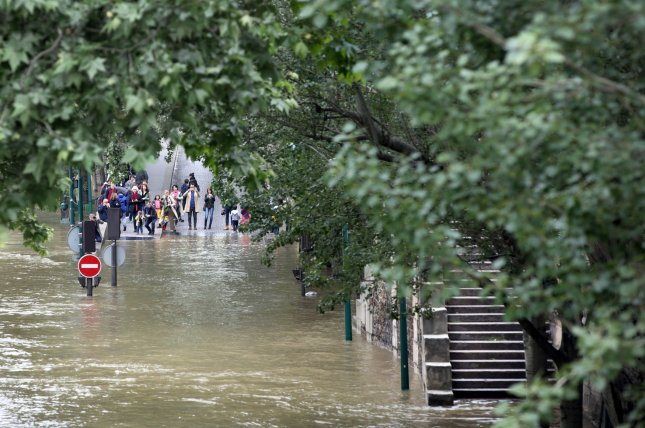 The Seine River, seen here last week, receded from flood levels as it passed through Paris, prompting the government and insurers to begin assessments and plans for disbursements. Photo by Maya Vidon-White/UPI