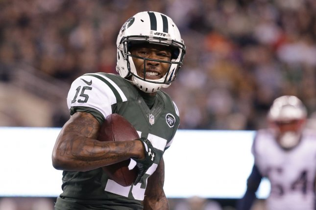 New York Jets Brandon Marshall carries the football in the first half against the New England Patriots in week 12 of the NFL at MetLife Stadium in East Rutherford, New Jersey on November 27, 2016. Photo by John Angelillo/UPI