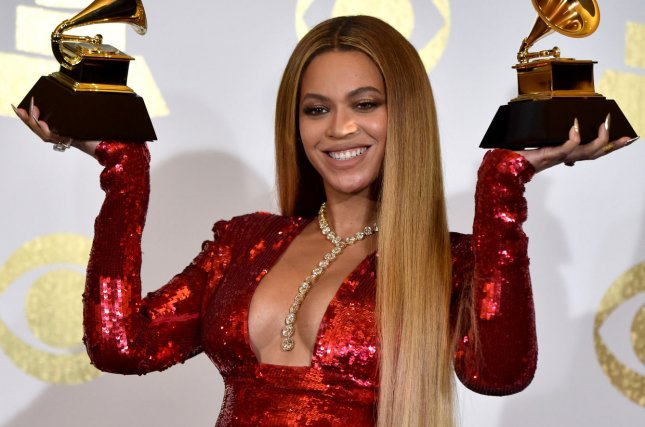 Beyonce appears backstage with her awards for Best Music Video for Formation and Best Urban Contemporary Album for Lemonade during the 59th annual Grammy Awards on February 12. Beyonce whips her hair back and fourth in new baby bump photos released on Instagram. File Photo by Christine Chew/UPI