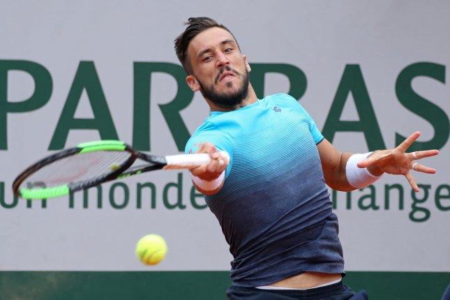 Damir Dzumhur of Bosnia and Herzegovina hits a shot during his French Open third-round match against Alexander Zverev of Germany Friday at Roland Garros in Paris. Photo by David Silpa/UPI