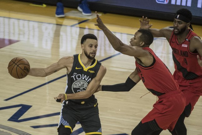 Golden State Warriors point guard Stephen Curry is a three-time NBA champion. Photo by Terry Schmitt/UPI