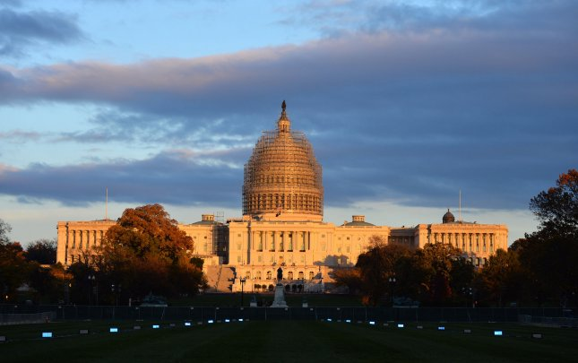 The sun sets on the Capitol Building in Washington, D.C. File Photo by Kevin Dietsch/UPI