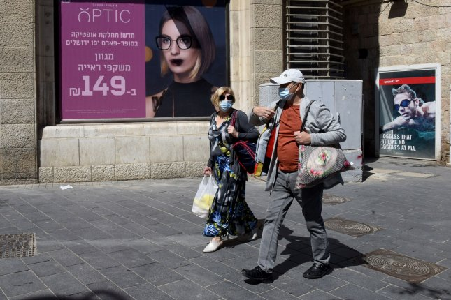 Israelis wear mandatory face masks due to the COVID-19 pandemic while they shop in Jerusalem, Israel, on Friday. Photo by Debbie Hill/UPI