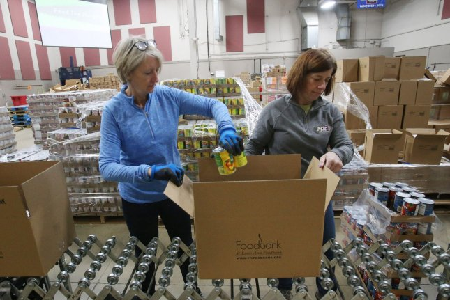 Volunteers pack food supplies for shut-in seniors at St. Louis Area Foodbank in Bridgeton, Mo., on March 23. Photo by Bill Greenblatt/UPI
