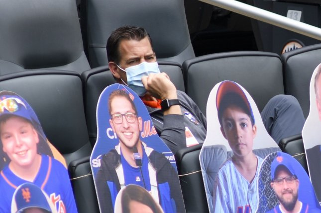 New York Mets general manager Brodie Van Wagenen, seen during a summer camp workout on July 17, sits behind cardboard cutouts of fans in the stands. He was hired as the Mets' GM prior to the 2019 season. File Photo by Corey Sipkin/UPI
