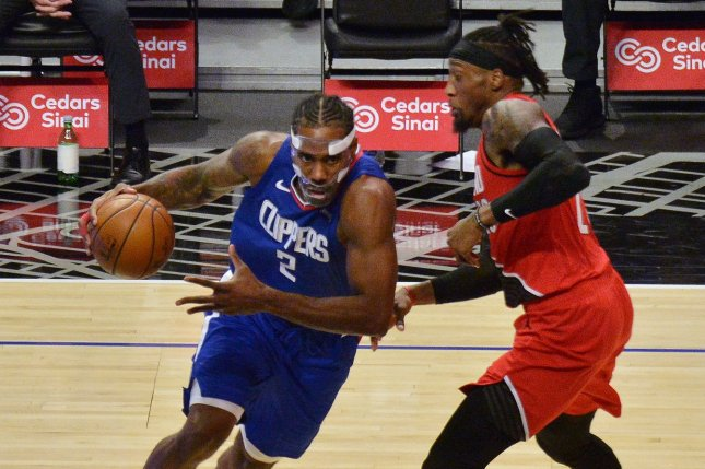 Los Angeles Clippers forward Kawhi Leonard (L) drives toward the rim during a win over the Portland Trail Blazers on Wednesday in Los Angeles. Photo by Jim Ruymen/UPI
