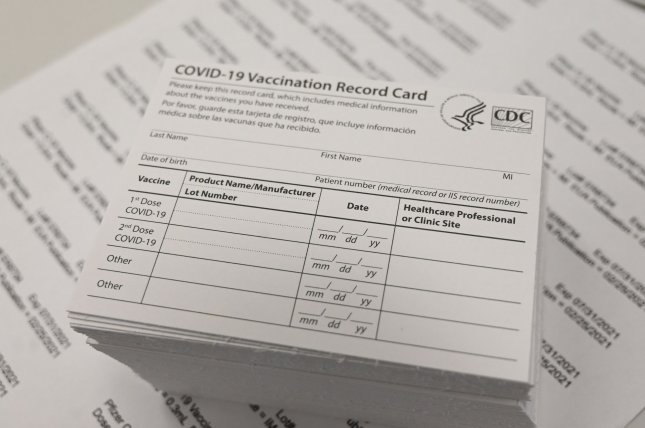 The two-dose COVID-19 vaccines reduce infection risk by up to 90%, according to new CDC data. File Photo by Ian Halperin/UPI