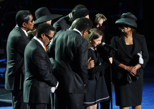Paris Jackson is comforted by her family during the Jackson public memorial service held at Staples Center in Los Angeles on July 7, 2009. The King of Pop died in Los Angeles on June 25 at age 50. (UPI Photo Photo/Mario Anzuoni/Pool)
