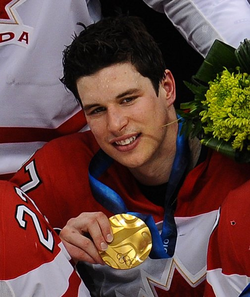 Canada's Sidney Crosby poses with the gold medal he earned after scoring on USA's Ryan Miller to win in overtime of the gold medal men's ice hockey game at Canada Hockey Place in Vancouver, Canada, during the 2010 Winter Olympics, Feb. 28, 2010. UPI/Roger L. Wollenberg
