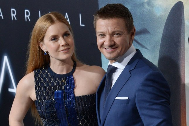 Amy Adams (L) and Jeremy Renner at the Los Angeles premiere of Arrival on Sunday. Photo by Jim Ruymen/UPI