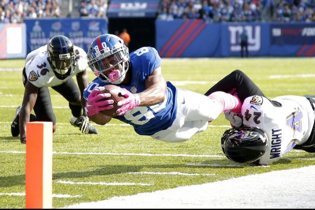 New York Giants Victor Cruz dives for the endzone but comes up gaining 17 yards and tackled by Baltimore Ravens Shareece Wright in the 3rd quarter in week 6 of the NFL at MetLife Stadium in East Rutherford, New Jersey, on October 16, 2016. The Giants defeated defeated the Ravens 27-23. Photo by John Angelillo/UPI