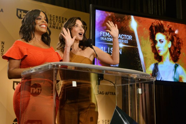 Actresses Niecy Nash (L) and Olivia Munn announce nominations onstage for the 24th annual SAG Awards in West Hollywood, Calif. on Wednesday. Photo by Jim Ruymen/UPI