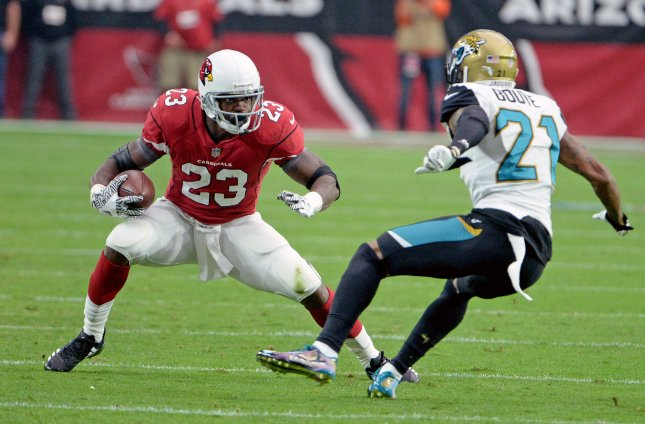Arizona Cardinals running back Adrian Petersontries to fake out Jacksonville Jaguars' defensive back A.J. Bouye during their game in October. Photo by Art Foxall/UPI