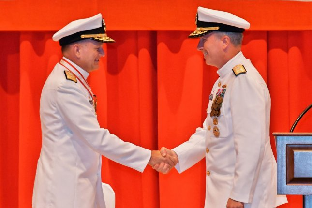 Rear Adm. Gregory J. Fenton, L, shakes hands with Rear Adm. Brian P. Fort, the new commander, U.S. Naval Forces Japan during a change of command ceremony at the Fleet Activities Yokosuka, Japan, on July 10, 2019. Photo by Keizo Mori/UPI