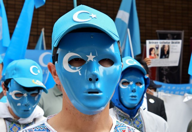 Participants wear a masks during a rally against the Communist China government in Osaka, Japan on June 29, 2019. Photo by Keizo Mori/UPI