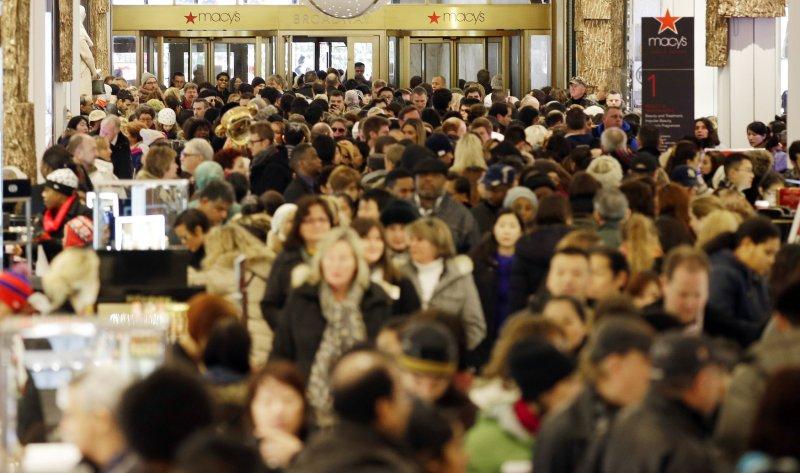 Shoppers walk through Macy's in Herald Square on Black Friday in New York City on November 29, 2013. UPI/John Angelillo