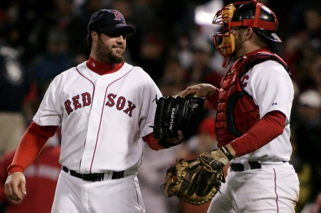 Boston Red Sox pitcher Eric Gagne (L) takes the ball from catcher Jason Varitek after Gagne struck out Cleveland Indians batter Grady Sizemore to win game one of the American League Championship Series Fenway Park in Boston on October 12, 2007. (UPI Photo/Matthew Healey)