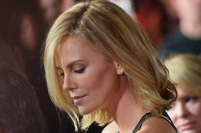 Actress Charlize Theron attends the premiere of the motion picture crime thriller The Gunman at Regal Cinemas L.A. Live in Los Angeles on March 12, 2015. Photo by Jim Ruymen/UPI