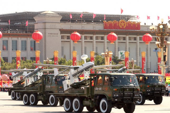 Chinese soldiers participate in a massive military parade celebrating the 60th anniversary of the founding of Communist China, in Beijing October 1, 2009. The Victory Day parade on Sept. 3 is to feature a procession of China's military including tanks and aerial displays over Chang'an Avenue, and residents have been banned from having guests and from opening their windows during the event. UPI/Stephen Shaver