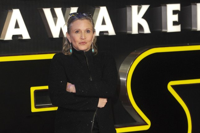 """American actress Carrie Fisher attends the European premiere of """"Star Wars: The Force Awakens"""" in London on December 16, 2015. Fisher remained hospitalized Saturday following a heart attack Friday. File Photo by Paul Treadway/ UPI"""
