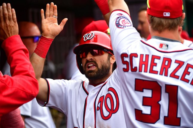 Washington Nationals' Adam Eaton celebrates in the dugout after scoring. File photo by Kevin Dietsch/UPI