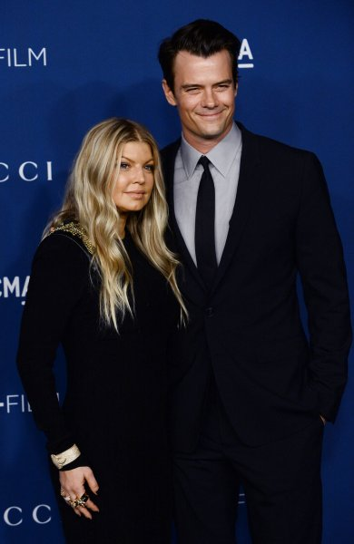 Singer Fergie and her husband, actor Josh Duhamel, arrive at the LACMA Art + Film gala in Los Angeles on November 2, 2013. The couple announced Thursday they have split up after eight years of marriage. File Photo by Jim Ruymen/UPI