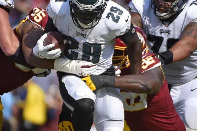Philadelphia Eagles running back LeGarrette Blount (29) runs for short yardage against Washington Redskins defenders Jonathan Allen (95) and Stacy McGee (92) during the second half of an NFL game at FedEx Field in Landover, Maryland, September 10, 2017. File photo by David Tulis/UPI