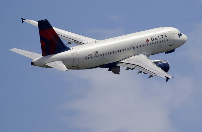 A Delta Airlines plane, like the one pictured above, on its way to Atlanta, Ga. was forced to turn back to Detroit, Mich. after a small bird was discovered in the cockpit. File Photo by John Angelillo/UPI