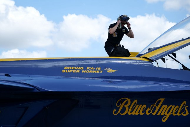 The U.S. Navy Blue Angels ground crew performs a check out of the F/A 18 after arriving at the Ft Lauderdale-Hollywood-International Airport for media day in Ft. Lauderdale, Fla., Thursday. Photo By Gary I Rothstein/UPI