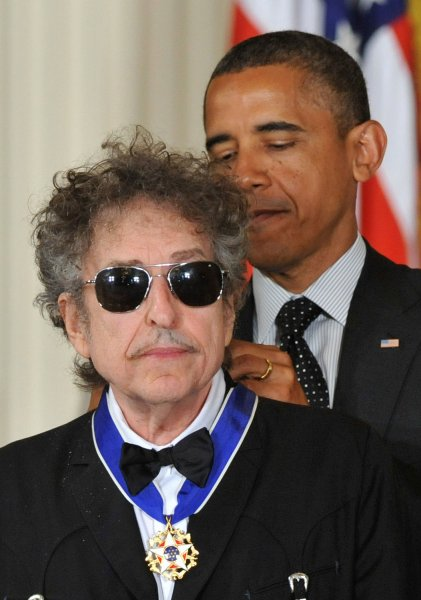 President Barack Obama awards the the Presidential Medal of Freedom to singer/songwriter Bob Dylan during a ceremony in the East Room at the White House in Washington on May 29, 2012. The Medal of Freedom is our NationÕs highest civilian honor, presented to individuals who have made especially meritorious contributions to the security or national interests of the United States, to world peace, or to cultural or other significant public or private endeavors. UPI/Kevin Dietsch