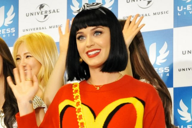 Singer Katy Perry(R) and South Korean girl group Girls' Generation attend a press conference during the U-Express Live 2014 in Saitama Prefecture, Japan, on March 2, 2014. UPI/Keizo Mori