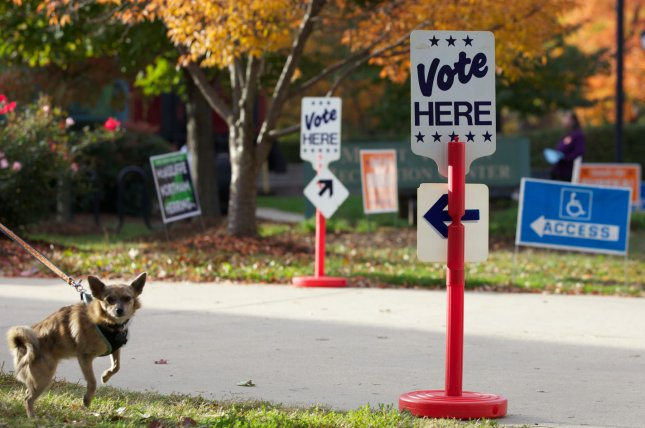 Vote Here signs are on display at a polling place in Alexandria, Va. (File/UPI/Molly Riley)