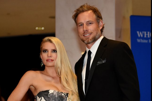 Jessica Simpson (L) and Eric Johnson at the White House Correspondents' Association gala on May 3, 2014. The couple shared some playful PDA on a date night Saturday. File Photo by Molly Riley/UPI