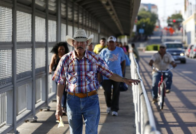 People makes their way to Mexico as they cross the Gateway to the Americas International Bridge at the U.S.-Mexico border near Laredo, Texas on July 23, 2015. Photo by Aaron M. Sprecher/UPI