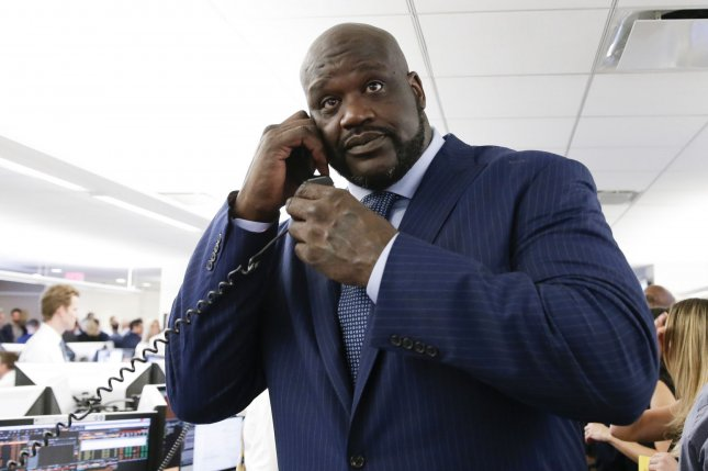 Shaquille O'Neal speaks to a client at the 2017 BTIG Commissions for Charity Day on May 2 in New York City. Photo by John Angelillo/UPI