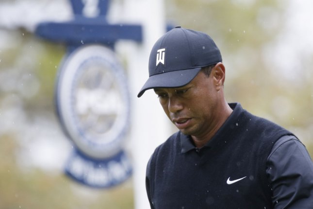Tiger Woods walks to the fairway after his tee ball on the 2nd hole in the second round of the PGA Championship on Friday at The Black Course at Bethpage State Park in Farmingdale, New York. Photo by John Angelillo/UPI