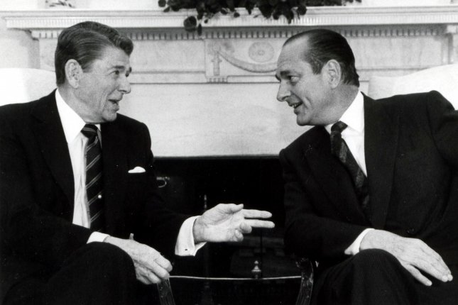 U.S. President Reagan meets with French Prime Minister Jacques Chirac at the White House on March 31, 1987. File Photo by Doug Mills/UPI