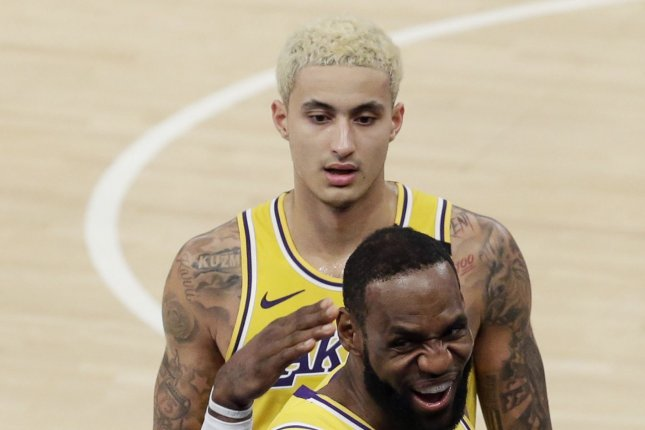 Los Angeles Lakers star Kyle Kuzma (top) hit the decisive shot in his team's win against the Denver Nuggets on Monday in Orlando, Fla. File Photo by John Angelillo/UPI
