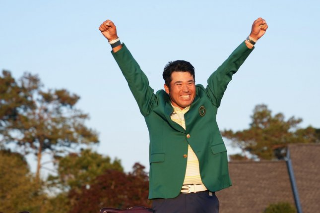 Masters champion Hideki Matsuyama of Japan celebrates while wearing the Green Jacket after the final round of the 2021 Masters Tournament on Sunday at Augusta National Golf Club in Augusta, Ga. Photo by Kevin Dietsch/UPI