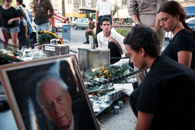 Young Israelis place candles at the site where the late Prime Minister Yitzhak Rabin was killed in Tel Aviv October 21,1999, which marked the fourth anniversary of his assassination according to the Jewish calendar. File Photo by George Waizmann/UPI
