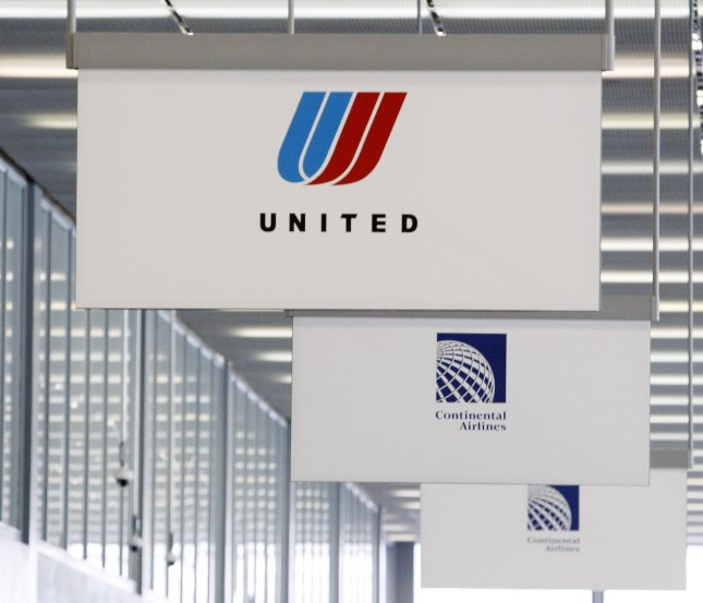 Signs for United Airlines and Continental Airlines direct passengers to ticket counters at O'Hare International Airport in Chicago on May 3, 2010. UPI/Brian Kersey
